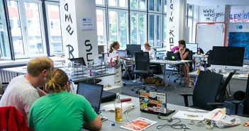 Visitors sit at laptop and desktop computers inside the Plug and Play Accelerator startup business center, jointly run by newspaper publisher Axel Springer SE and Plug and Play Tech Center, in Berlin, Germany, on Wednesday, June 11, 2014. Axel Springer, Europe's biggest newspaper publisher, is working with JPMorgan Chase & Co. and Citigroup Inc. on an initial public offering of its digital-classifieds business, people familiar with the matter said. Photographer: Krisztian Bocsi/Bloomberg