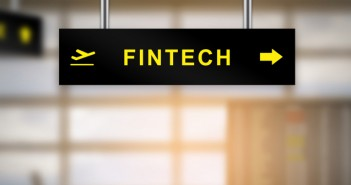 FINTECH or financial technology on airport sign board with blurred background and copy space