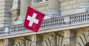 Bundeshaus Facade with Swiss Flag in Bern, Switzerland