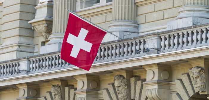 Bundeshaus Facade with Swiss Flag in Bern, Switzerland